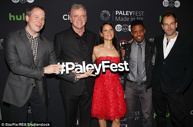 Elementary crew: (Left to right) Executive producer and creator Robert Doherty, Aidan Quinn, Lucy, Jon Michael Hill, and Jonny Lee Miller share a smile on the red carpet
