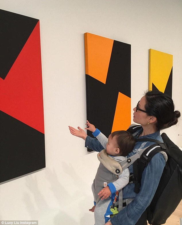'A little culture with my little one': Lucy shared another image to Instagram on Saturday of she and her one-year-old son Rockwell Lloyd enjoying an afternoon of art in the Big Apple
