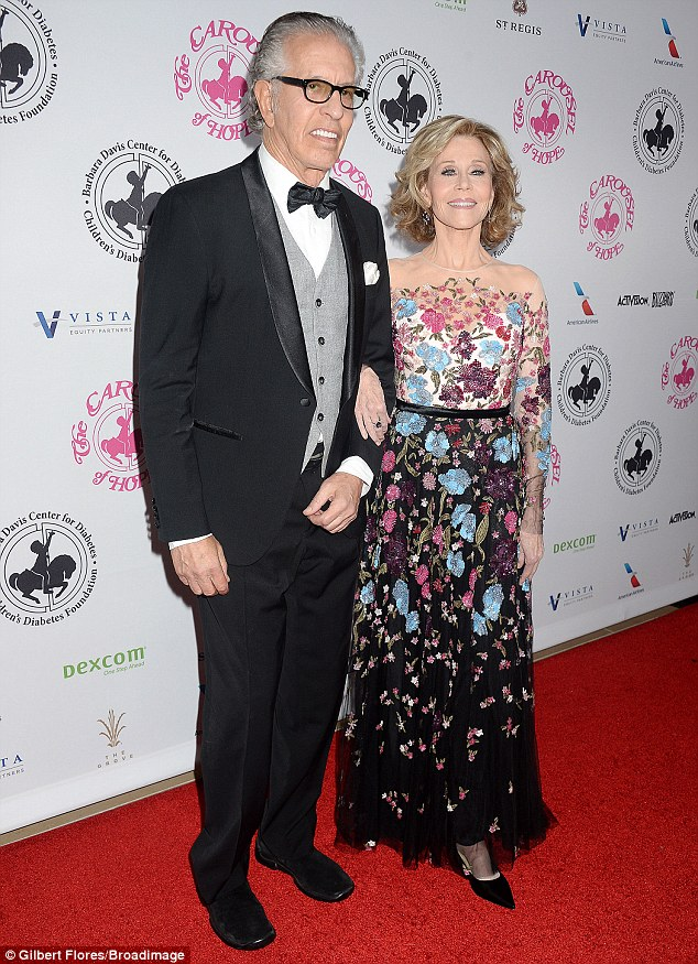 Date night:The 78-year-old actress posed with her record producer partner Richard Perry, who looked dapper in a suit and bow-tie