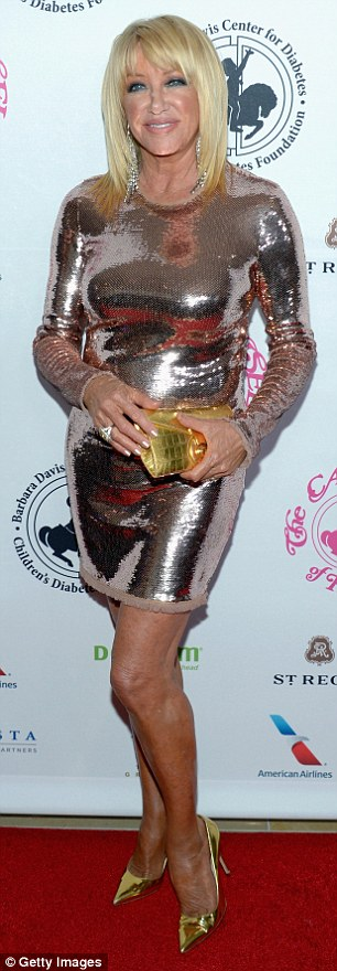 Center stage: Suzanne Somers donned a glittering mini rose gold dress with long sleeves and a high neck; the 69-year-old paired the shiny look with gold heels and a matching clutch