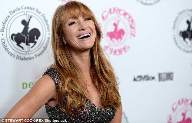 Good times:Jane Seymour chose a glittering gown with a v-neck and thigh-high slit; the British-born beauty wore her fringed tresses loose with a slight wave