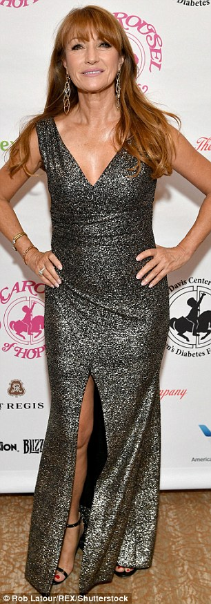 In the moment:The 65-year-old actress showed off her flawless figure in the fitted look, adding strappy black heels
