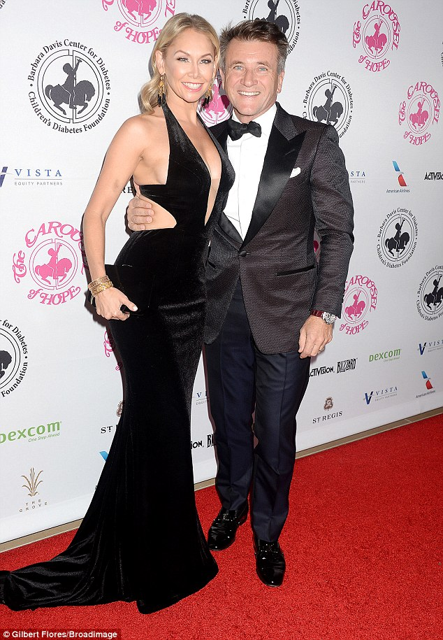 Happy life:Kym arrived to the ball with her husband Robert Herjavec - businessman and star of Shark Tank