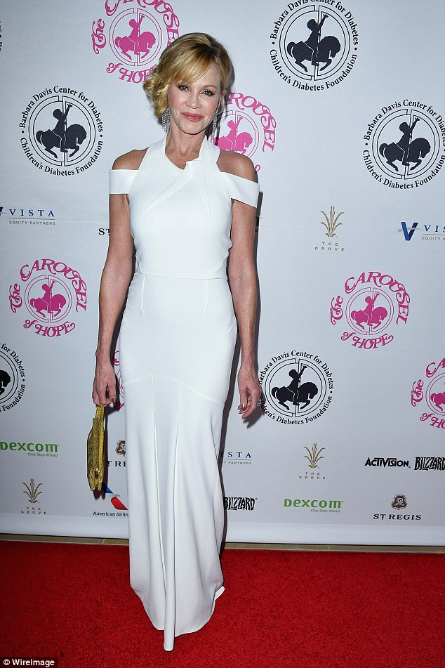 Simply stunning: Melanie Griffithlooked absolutely heavenly in a floor length white gown with exposed shoulders at the Carousel of Hope Ball in Beverly Hills