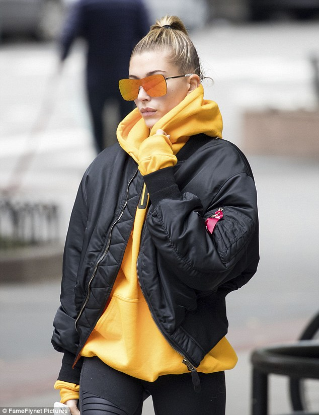 Keeping warm: Hailey styled her short blonde tresses into a high ponytail, opting for a makeup free face