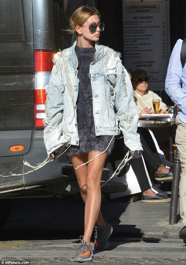 Model walk:The teen beauty wowed in a grey textured mini dress with a distressed denim jacket and sneakers while in France