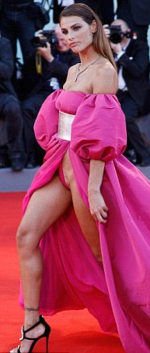 Jaw dropping: All eyes were on stunning Italian model Dayane Mello when she wore this risque pink dress to the Venice Film Festival