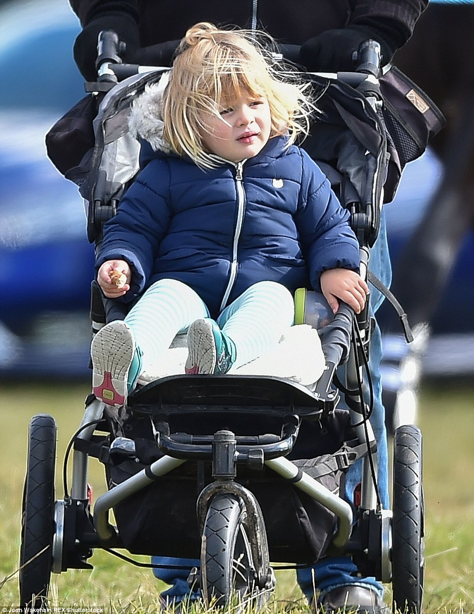 The two-year-old stayed cosy in a quilted jacket with a furry hood and a pair of woolly tights