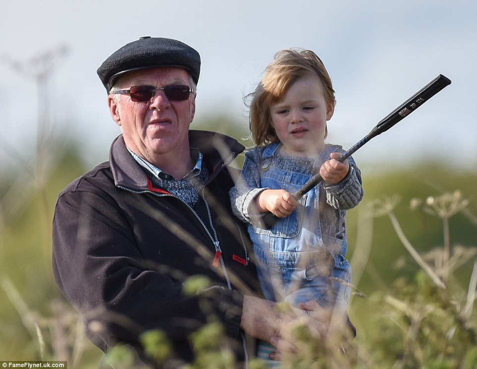 Little Mia clutches a black riding crop in her hands as her mother gets back in the saddle in Cirencester