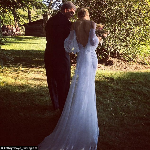 Elegant: The bride designed her own wedding dress which featured lace from her mother's gown