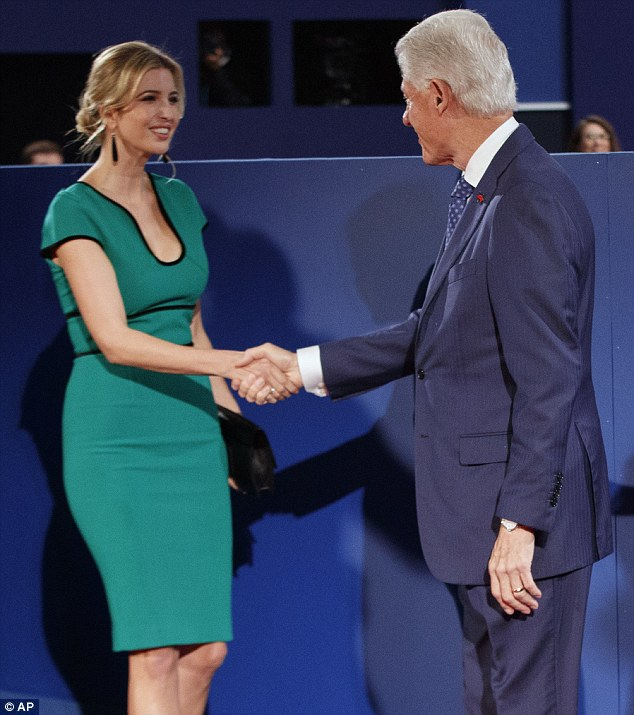 Flattering: Ivanka, who can be seen shaking former President Bill Clinton's hand, looked stunning in the emerald green dress, which featured a low neckline and black piping