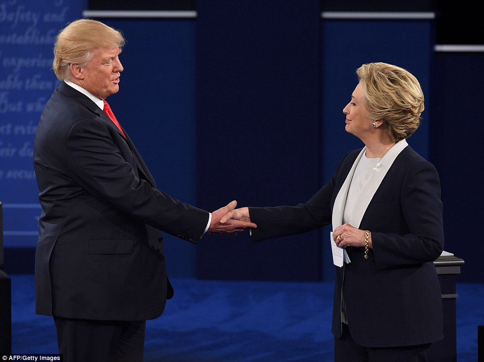 Donald Trump and Hillary Clinton shakes hands at the end of the second presidential debate in St Louis, Missouri, on Sunday
