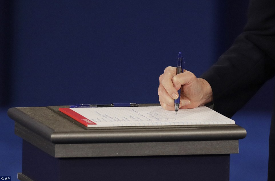 Democratic presidential nominee Hillary Clinton takes notes during the second presidential debate against Donald Trump