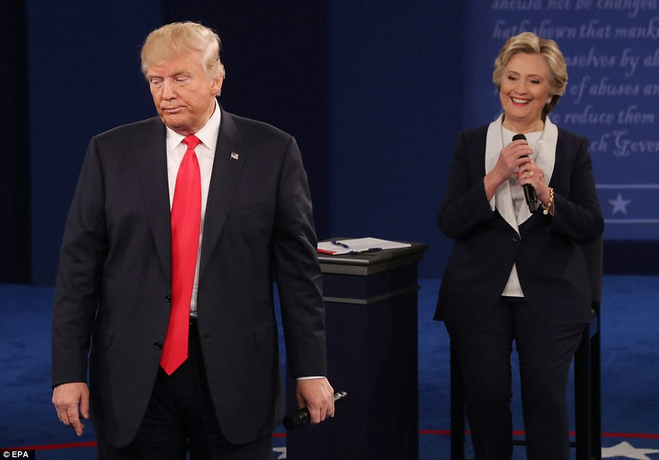 Democratic nominee for president Hillary Clinton on stage during the second debate as Republican candidate Donald Trump frowns