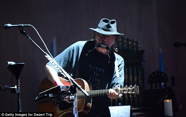 Legend: The folksy singer, who followed Friday's riveting Rolling Stones show, mellowed things out with such fave tunes After the Gold Rush and Heart of Gold on Day 2 of the event
