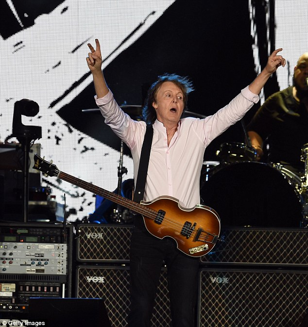 I've got blisters on my fingers: Paul made the peace sign as he waved to the crowd
