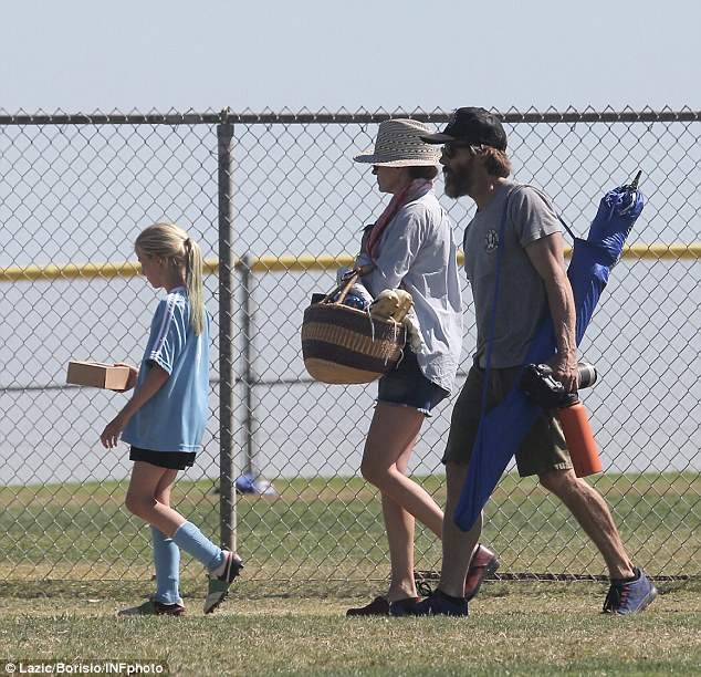 Packin' it in: The happy family walked off the field after a full day of soccer fun