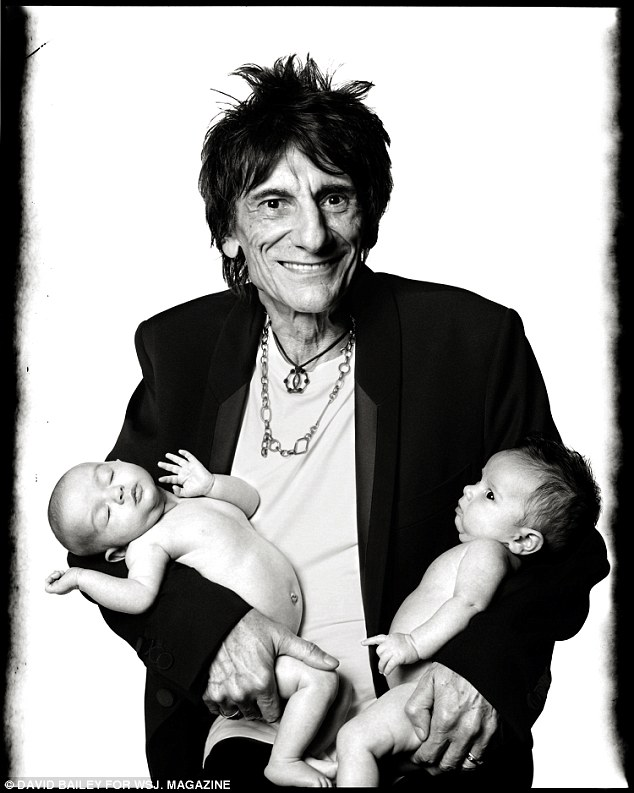 Proud father Ronnie beams in the David Bailey portrait as he holds his baby twins, born just done day before his 69th birthday, in his arms
