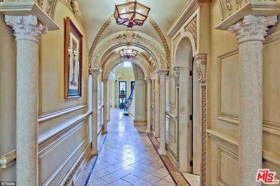 The house features beautiful arches reminiscent of classic European architecture