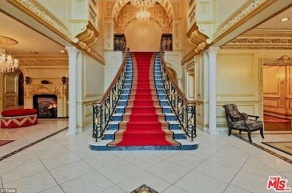 Above, a view of a grand stairway in the home, which is located in one of the country's most expensive zip codes