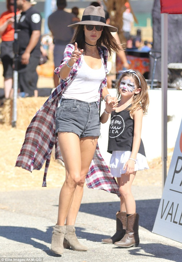 Mommy and me! The 35-year-old supermodel donned a pair of tiny cutoffs as she spent the day with her two kids including daughter Anja, aged eight