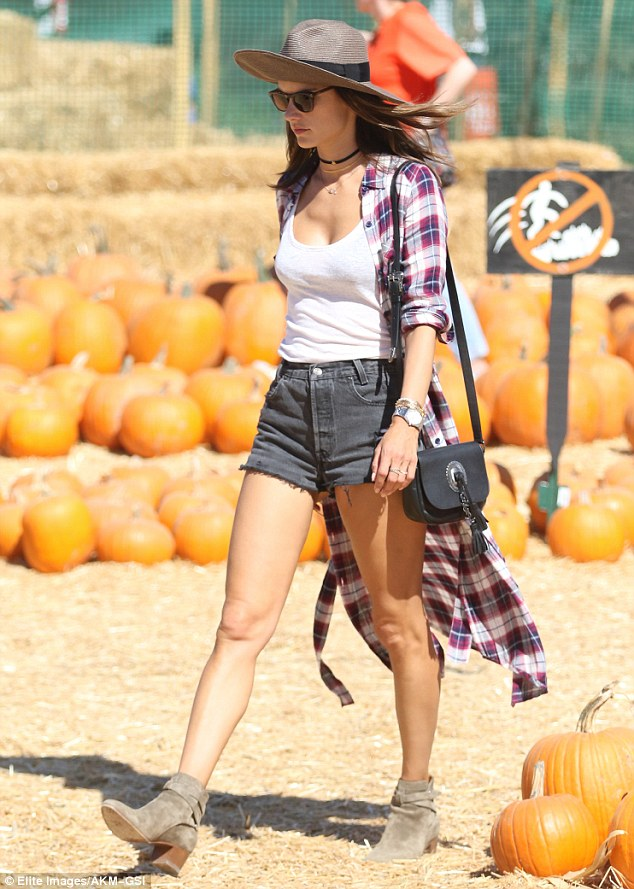 Check-er out! Alessandra layered a red, navy and white plaid shirt over her ensemble for a laid-back cowgirl vibe