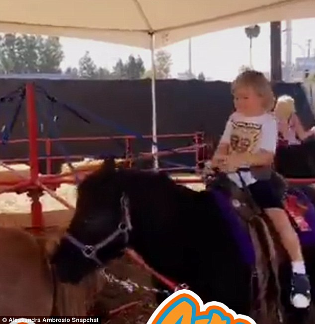 Giddy up! The beauty filmed Anja and Noah as they rode on ponies