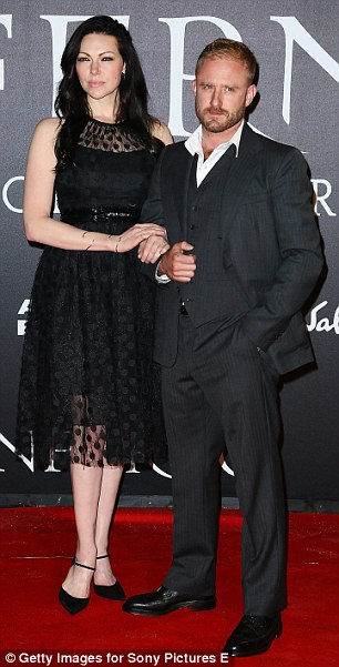 Affectionate: Laura Prepon clung to the arm of her fiancé Ben Foster