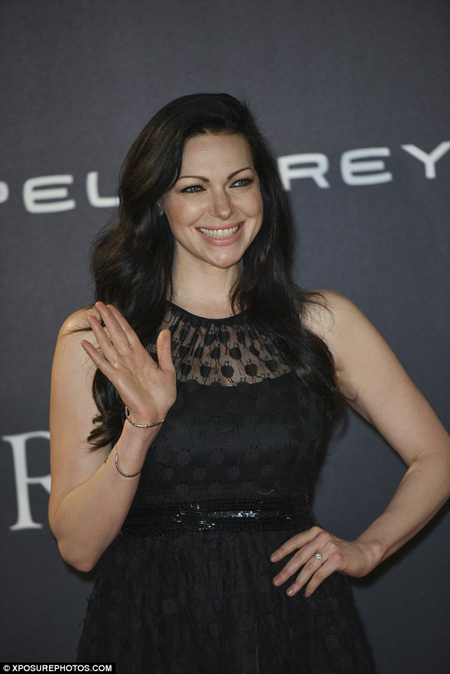 Lighting up the red carpet: The pretty star waved at the paparazzi while flashing a bright smile