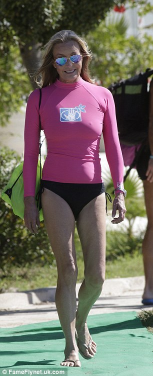 Toned: She wore a pink swimming top and black bikini bottoms