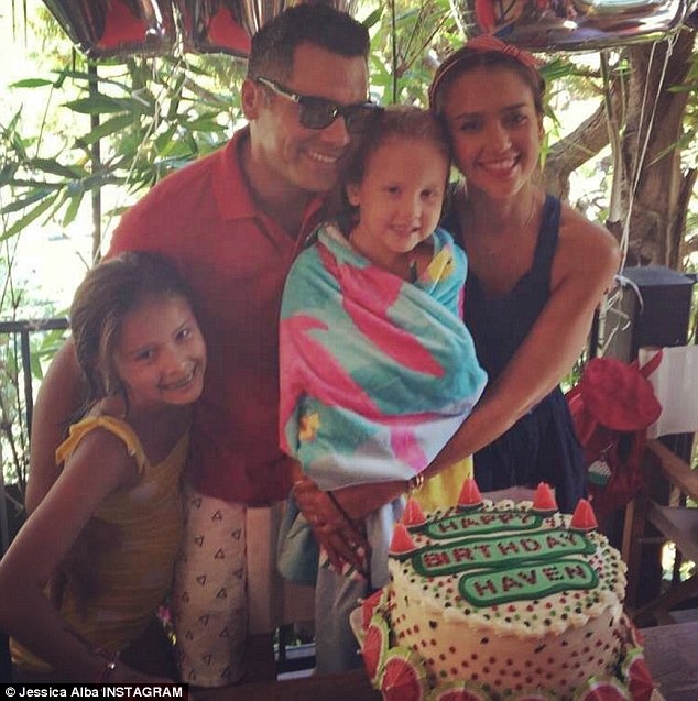 Devoted:The Into The Blue actress has two children with husband Cash Warren, 37; pictured: (from l to r) Honor, Cash, Haven and Jessica