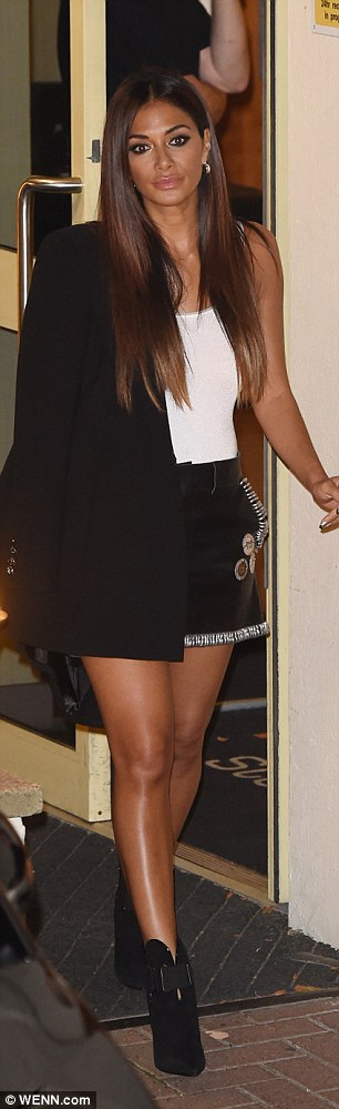 Stepping out: The beauty showed off her slender pins in the rock-chic skirt which boasted a hem of silver rings