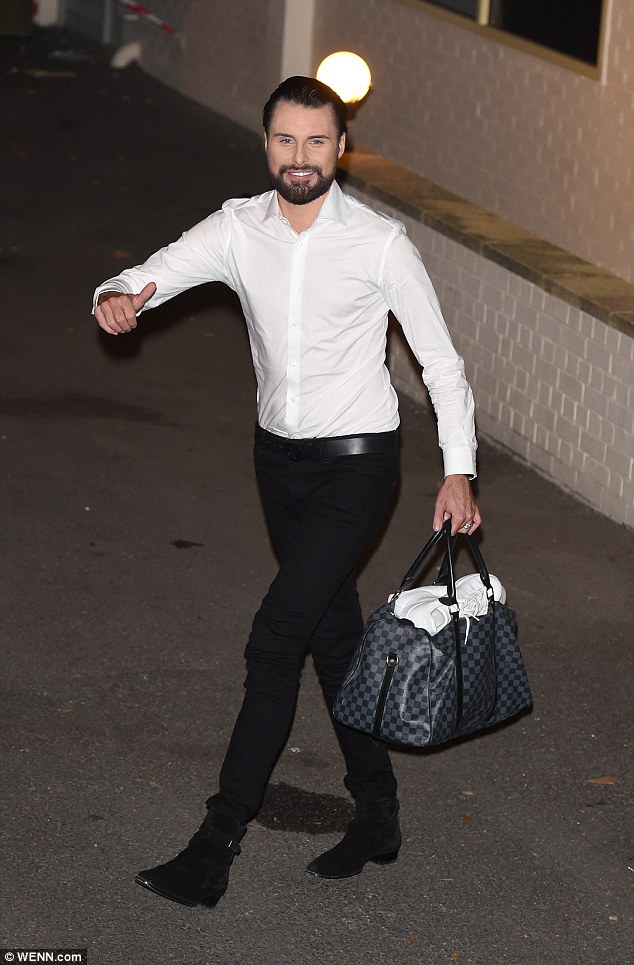 Dapper: Rylan Clark-Neal looked to be full of beans as he bound through the night in a white shirt and black trousers