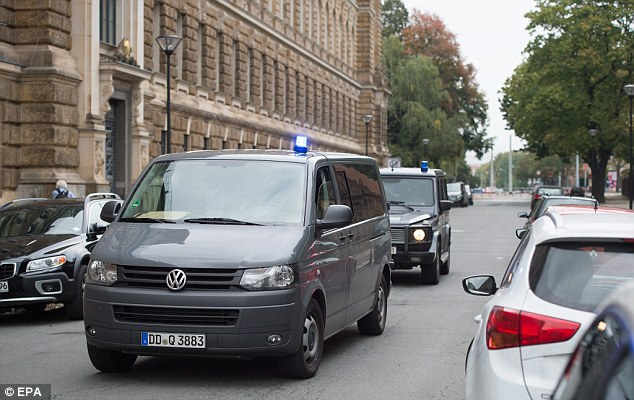Jaber al-Bakr is due to be brought before a judge at a Dresden court later today. Police vehicles are pictured at the court