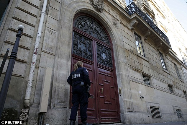 A police officer stands guard at the entrance of a luxury residence on the Rue Tronchet in central Paris, France, where masked men robbed U.S. reality TV star Kim Kardashian West at gunpoint, stealing jewellery worth millions of dollars, police and her publicist said