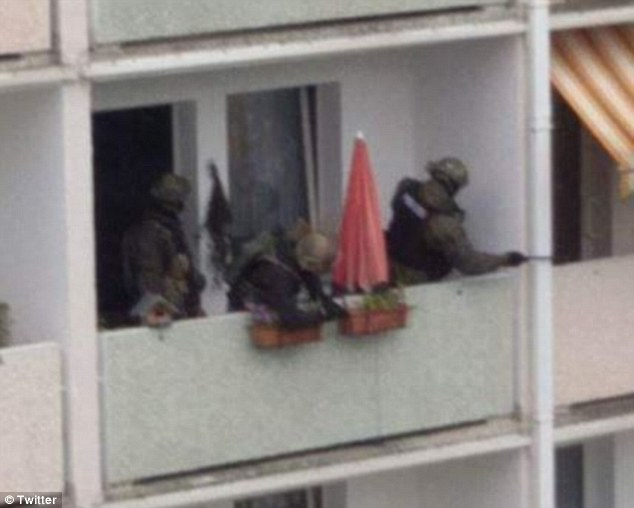 Raid: Officers surrounded a home in Chemnitz on Saturday and discovered 'highly volatile' explosive material