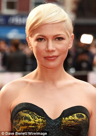Femme fatale: The sweetheart neckline showed off her delicate decolletage and gorgeous glowing skin, while still remaining sexy through its structured bodice design