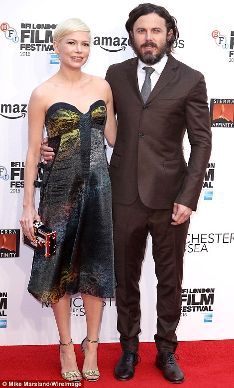 Looking good: Ensuring her look was completely co-ordinated, Michelle finished the ensemble with a pair of vibrant yellow stiletto snakeskin heels as she posed beside co-star, Casey Affleck