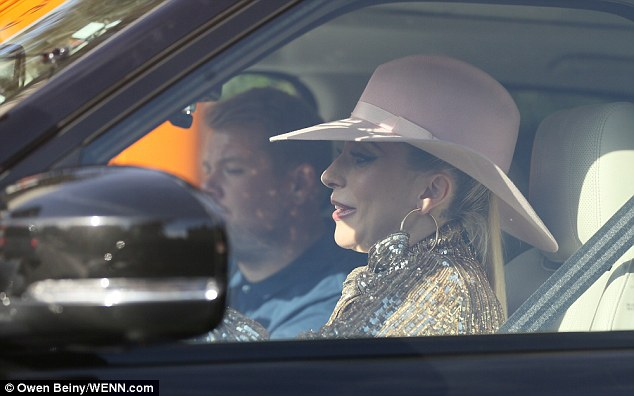 Ready to ride: She spruced her outfit further with a pink cowboy hat