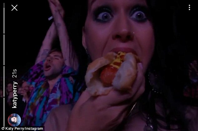 Hot dog: Katy gorged on a mustard and ketchup covered hot dog during the show