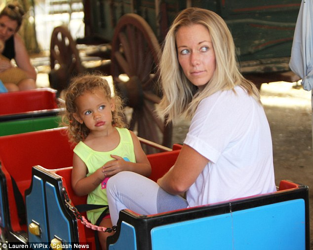 All aboard: The 31-year-old took her daughter for a ride on the kiddie train