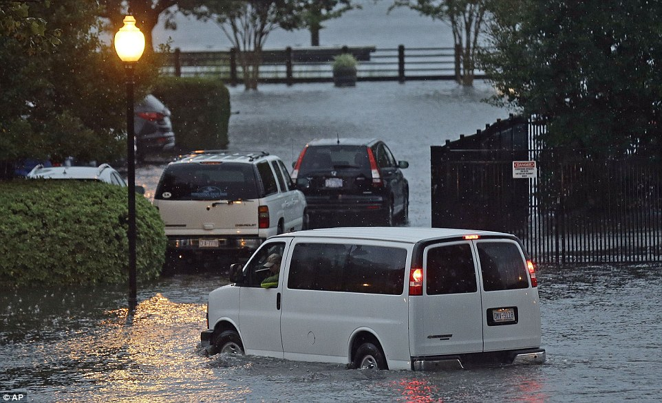 Many in North Carolina were left  stranded in their cars due to flash flooding caused by Matthew (pictured is Wilmington beside the Cape Fear River on Saturday)
