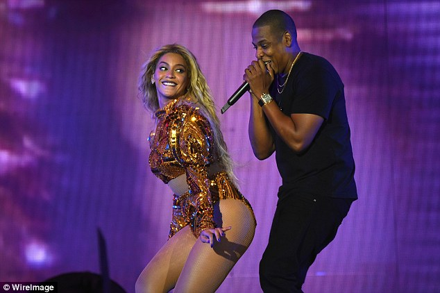 Twerk it:The mother-of-one also donned a glittery two-piece bronze number as she twerked up a storm when she was joined by her rapper husband Jay Z on-stage