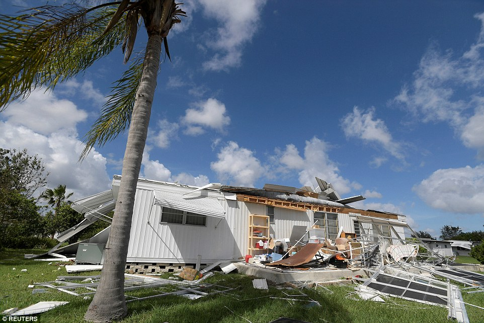 The extent of Matthew's damage in Florida (pictured is Port Orange), where six people were killed, could be seen on Sunday