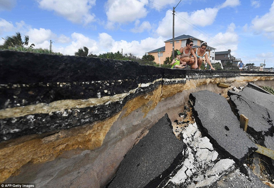 Local residents surveyed the damage caused to their town after Matthew wreaked havoc up the state on Friday
