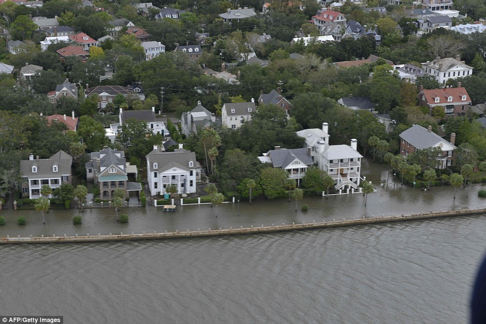 This aerial photo shows the extent of flooding in Charleston, where high tides caused by Matthew sailed over the city's historical seawall and flooded the streets that were simultaneously being pounded with heavy rains