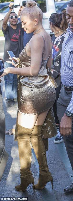 Causing a stir: Kylie's presence demanded attention from passerby