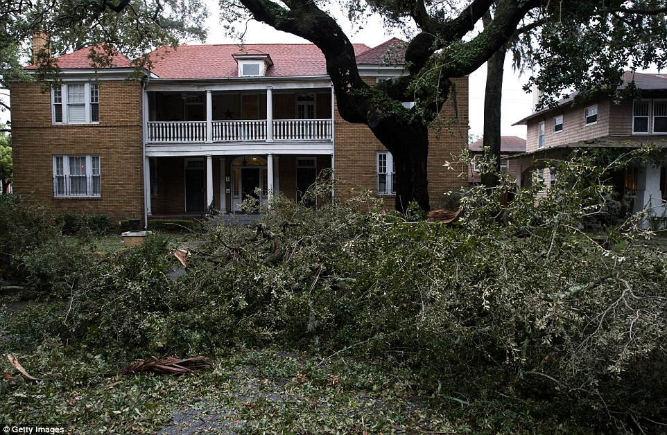 It has been estimated that Matthew will end up damaging roughly 1.5million residential and commercial properties in Florida, Georgia and South Carolina. Pictured here is a home in Savannah