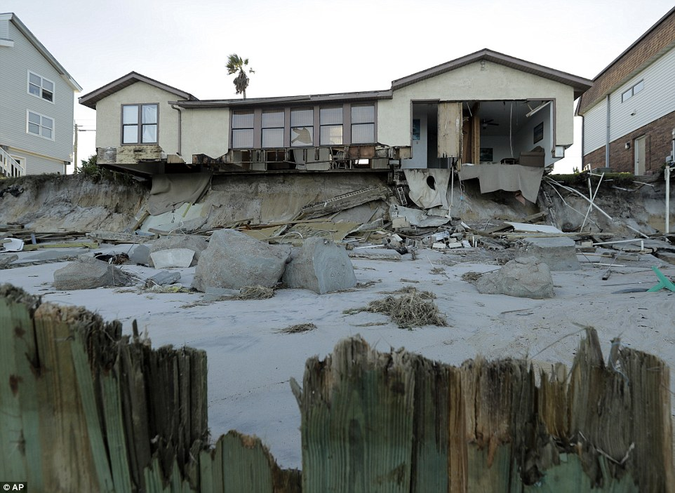A beachfront home in Ponte Vedra Beach, Florida, was ravaged by the storm, the wall of its living room ripped clean off