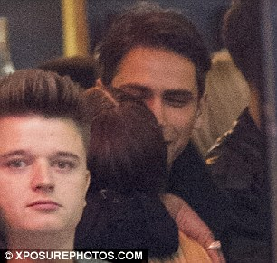 Cosy: The hunky actor then drew the pretty blonde in for a hug